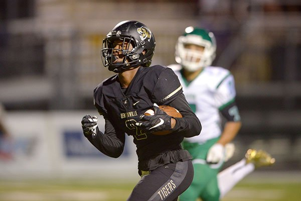 Kam'ron Mays-Hunt, Bentonville wide receiver, runs for a touchdown in the first quarter on Friday Sept. 30, 2016, during the game in Bentonville's Tiger Stadium.