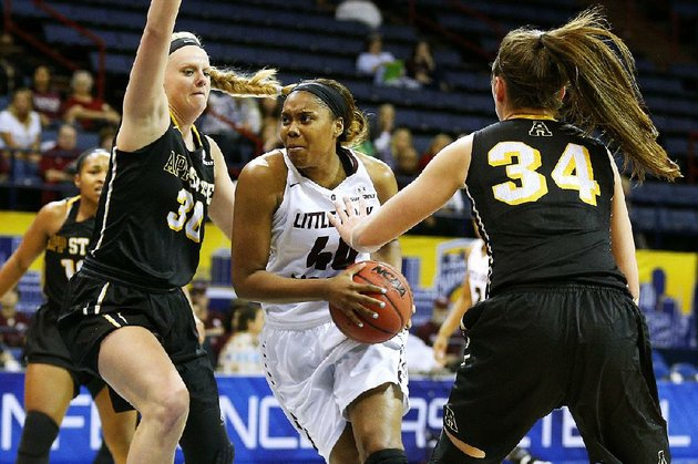 ualr-forward-kaitlyn-pratt-center-drives-between-appalachian-state-defenders-ashley-bassett-smith-left-and-madi-story-during-the-quarterfinals-of-the-sun-belt-conference-tournament-on-thursday-pratt-had-20-points-and-eight-rebounds-in-the-trojans-69-53-victory