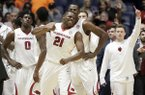 Arkansas guard Manuale Watkins (21) celebrates with teammates after Arkansas beat Mississippi 73-72 in an NCAA college basketball game at the Southeastern Conference tournament Friday, March 10, 2017, in Nashville, Tenn. (AP Photo/Wade Payne)