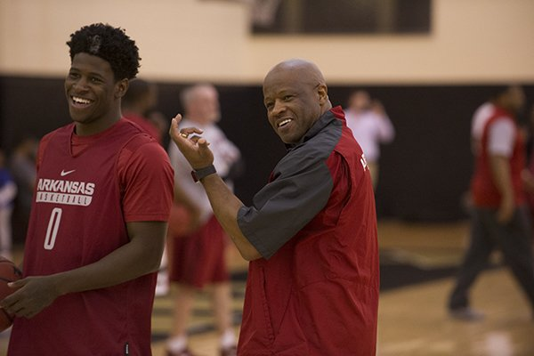 Arkansas junior guard Jaylen Barford, left, and Arkansas coach Mike Anderson smile during practice Thursday, March 9, 2017, at Vanderbilt University in Nashville, Tenn.