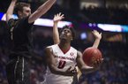 Arkansas' Jaylen Barford drives around Vanderbilt's Luke Kornet during an SEC Tournament game Saturday, March, 11, 2017, at Bridgestone Arena in Nashville, Tenn. Arkansas beat Vanderbilt 76-62 and will play Kentucky in the tournament championship game on Sunday.