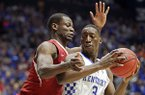 Arkansas forward Moses Kingsley, left, pressures Kentucky forward Edrice Adebayo (3) in the first half of an NCAA college basketball game for the championship of the Southeastern Conference tournament Sunday, March 12, 2017, in Nashville, Tenn.