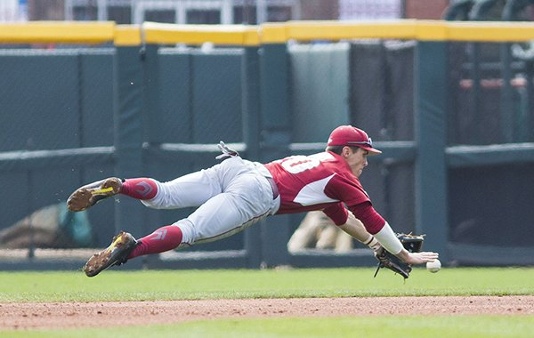 Arkansas second baseman Carson Shaddy makes a diving stop during a game against Rhode Island on Sunday, March 12, 2017, in Fayetteville.