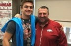 Hog tight end commitment Luke Ford and Coach Bret Bielema.