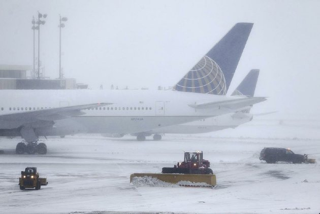 snowplows-work-on-the-tarmac-at-newark-liberty-international-airport-in-new-jersey-on-tuesday-flights-were-canceled-at-airports-across-the-northeast