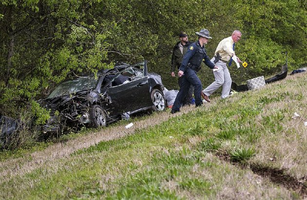 arkansas-democrat-gazettebenjamin-krain-31417-lonoke-county-sheriff-department-and-state-police-investigate-and-accident-in-north-little-rock-that-injured-two-people-after-they-were-ejected-from-a-stolen-vehicle-during-a-high-speed-chase-the-driver-refused-to-pull-over-for-a-lonoke-county-sheriffs-office-deputy-during-a-traffic-vilation-in-cabot-around-1230-tuesday-and-led-several-other-law-enforcement-vehicles-on-a-pursuit-until-it-hit-a-tree-while-exiting-interstate-40-westbound-at-highway-167-the-driver-who-had-multiple-warrants-out-for-his-arrest-and-the-passenger-were-seriously-injured-after-being-ejected