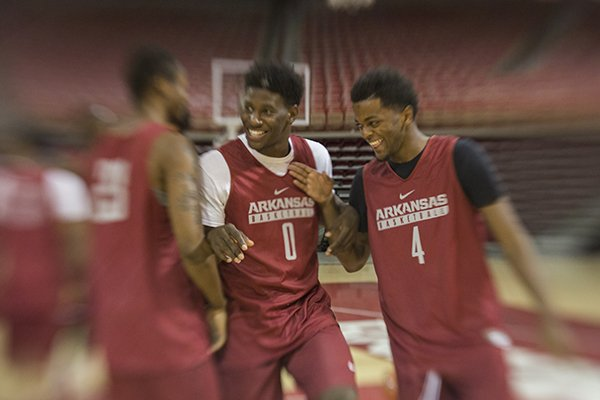 Arkansas guards Jaylen Barford (0) and Daryl Macon (4) interact during preseason media day on Wednesday, Oct. 5, 2016, in Fayetteville.