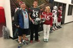 Arkansas tight end commit Luke Ford, center, with parents Tim and Lisa.