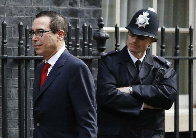 us-secretary-of-the-treasury-steven-mnuchin-passes-a-police-officer-thursday-on-downing-street-to-meet-britains-chancellor-of-the-exchequer-philip-hammond-in-london