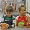 Loukas Gowthrop and Gabriella Zelaya work on creating mosaic flower pots during last year's spring b...