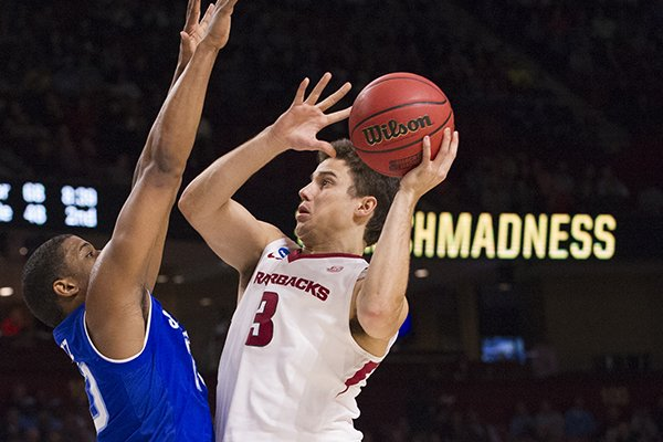 Arkansas guard Dusty Hannahs goes up for a shot during the Razorbacks' 77-71 NCAA Tournament win over Seton Hall on Friday, March 17, 2017, in Greenville, S.C.