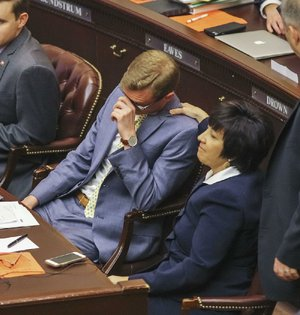 An emotional Rep. Grant Hodges, R-Rogers, House sponsor of Senate Bill 519, receives a comforting pat from Rep. Mary Bentley, R-Perryville, on Friday after the House approved the bill to separate the Robert E. Lee and Martin Luther King Jr. holidays.