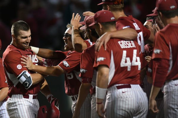 Arkansas first baseman Chad Spanberger (left) celebrates with Jake Arledge and other teammates after Spanberger's 3-run home run against Mississippi State Saturday, March 18, 2017, during the second inning at Baum Stadium in Fayetteville. Visit nwadg.com/photos to see more photographs from the game.