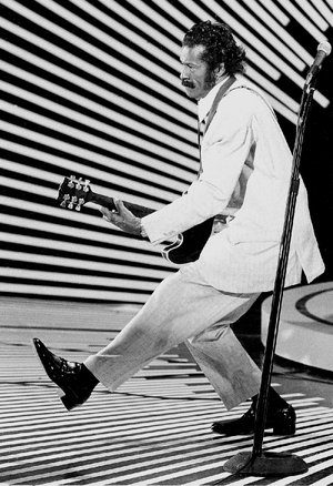 "In this April 4, 1980 file photo, guitarist and singer Chuck Berry performs his ""duck walk"" as he plays his guitar on stage. Chuck Berry died Saturday at the age of 90."