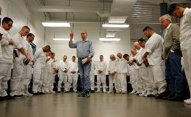 donny-kelly-leads-a-group-of-inmates-from-the-pathway-to-freedom-rehabilitation-program-in-a-prayer-at-the-end-of-a-discussion-friday-at-the-arkansas-department-of-corrections-hawkins-unit-on-its-wrightsville-campus