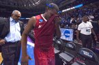 Arkansas senior Manny Watkins and his father, Razorbacks assistant coach Melvin Watkins walk off the floor following a 72-65 loss to North Carolina in the NCAA Tournament on Sunday, March 19, 2017, in Greenville, S.C.