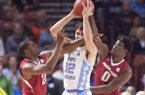 Arkansas' Manuale Watkins (left) and Jaylen Barford cover North Carolina's Luke Maye Sunday March 19, 2017 during the second round of the NCAA Tournament at the Bon Secours Wellness Arena in Greenville, South Carolina. The Tar Heels beat the Razorbacks 72-65 eliminating them from the tournament.