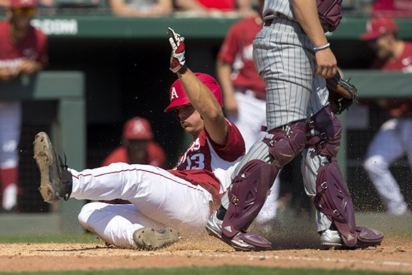 arkansas-jordan-mcfarland-slides-past-mississippi-state-catcher-dustin-skelton-sunday-march-19-2017-for-a-run-at-baum-stadium-in-fayetteville