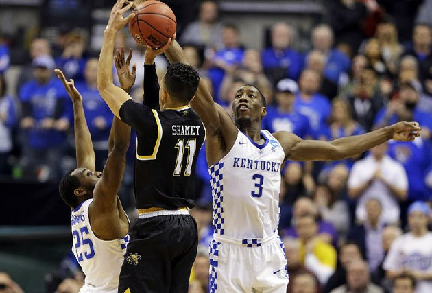 kentucky-forward-bam-adebayo-right-swats-away-a-potential-game-tying-shot-from-wichita-states-landy-shamet-to-advance-to-the-sweet-16-with-a-65-62-victory-in-indianapolis