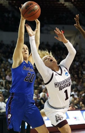 Mississippi State guard Blair Schaefer (right) is fouled by DePaul's Kelly Campbell as she drives for a layup in the first half of the Bulldogs 92-71 victory in Starkville, Miss.