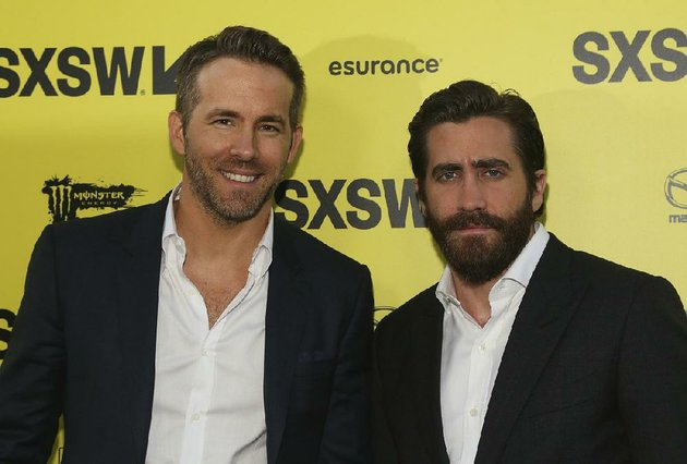 ryan-reynolds-left-and-jake-gyllenhaal-arrive-for-the-world-premiere-of-life-at-the-zach-theatre-during-the-south-by-southwest-film-festival-on-saturday-march-18-2017-in-austin-texas