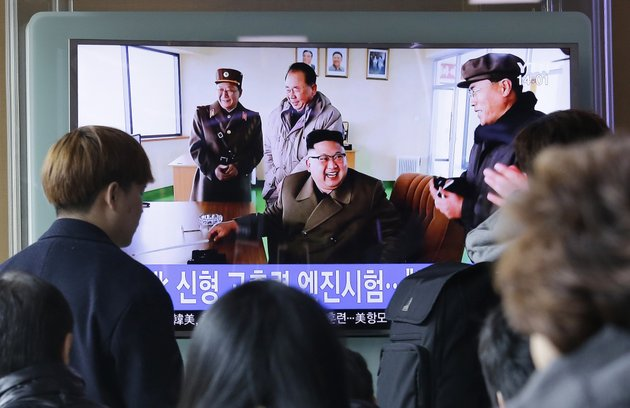 people-watch-a-tv-news-program-showing-an-image-published-in-north-koreas-rodong-sinmun-newspaper-of-north-korean-leader-kim-jong-un-at-the-countrys-sohae-launch-site-at-seoul-railway-station-in-seoul-south-korea-sunday-march-19-2017-north-korea-has-conducted-a-ground-test-of-a-new-type-of-high-thrust-rocket-engine-that-leader-kim-jong-un-is-calling-a-revolutionary-breakthrough-for-the-countrys-space-program