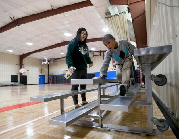 stevenson-right-6-helps-volunteer-cindy-mao-friday-as-they-clean-the-bleachers-in-the-yvonne-richardson-community-center-in-fayetteville-city-staff-completed-a-lighting-and-insulation-upgrade-for-the-center-in-2015-that-included-led-lighting-inside-the-gymnasium-as-well-as-an-led-lighting-upgrade-in-gym-that-replaced-400-watt-lights-with-brighter-and-more-efficient-100-watt-lights-the-project-was-figured-to-have-a-6-year-pay-back-term