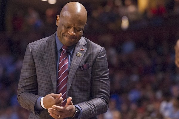 Arkansas head coach Mike Anderson pounds his fist during the second half against North Carolina Sunday March 19, 2017 during the second round of the NCAA Tournament at the Bon Secours Wellness Arena in Greenville, South Carolina. The Tar Heels beat the Razorbacks 72-65 eliminating them from the tournament.