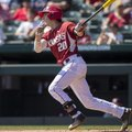 Arkansas's Carson Shaddy connects on a pitch Sunday, March 19, 2017, against Mississippi State at Ba...