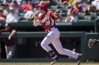 Arkansas's Carson Shaddy connects on a pitch Sunday, March 19, 2017, against Mississippi State at Baum Stadium in Fayetteville.