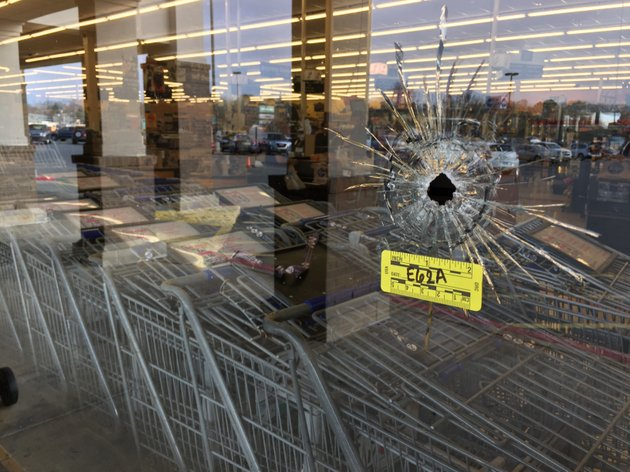 a-bullet-hole-is-seen-in-a-window-of-a-kroger-grocery-store-police-say-one-person-died-after-being-shot-in-the-parking-lot