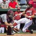 Arkansas' Luke Bonfield slides past Mississippi State catcher Dustin Skelton Sunday, March 19, 2017,...