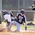 Bentonville West's Martin Keller (25) slides safely into home Tuesday behind Pea Ridge catcher Dylan...