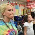Shannon Brown, a teacher at Adventure Club spring break camp, plays a game with students Tuesday to ...