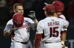 Arkansas catcher Grant Koch celebrates with center fielder Jake Arledge (15) after hitting a 2-run home run against New Orleans Wednesday, March 22, 2017, during the fifth inning at Baum Stadium.