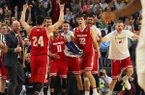 Wisconsin guard Bronson Koenig (24) joins players and coaches to celebrate their 65-62 victory against Villanova in a second-round men's college basketball game in the NCAA Tournament, Saturday, March 18, 2017, in Buffalo, N.Y. (AP Photo/Bill Wippert)