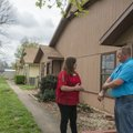 Toby Lankford, code enforcement officer, talks with Rachelle Goddard on Friday in Springdale. Lankfo...