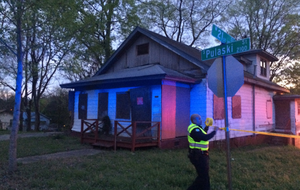 Police investigate a shooting on West 21st St. Sunday night.