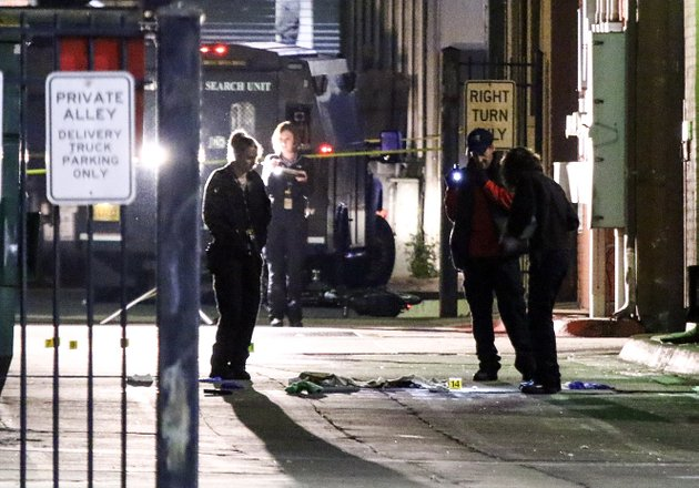 police-investigate-the-scene-of-a-fatal-officer-involved-shooting-early-the-morning-of-march-26-2017-in-an-alley-in-little-rocks-river-market-district
