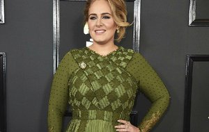 In this Feb. 12, 2017 file photo, Adele arrives at the 59th annual Grammy Awards in Los Angeles.