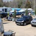 Customers cars are parked March 8 in front of several food trucks and mobile vendors at the Yacht Cl...