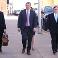 Former state Sen. Jon Woods (right) walks Tuesday with his attorney, Patrick Benca (far left), and o...