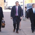 Former state Sen. Jon Woods (right) walks into the John Paul Hammerschmidt Federal Building Tuesday,...