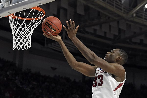 Arkansas's Moses Kingsley (33) drives to the basket against Seton Hall during the second half in a first-round game of the NCAA men's college basketball tournament in Greenville, S.C., Friday, March 17, 2017. (AP Photo/Rainier Ehrhardt)
