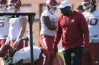 Arkansas assistant coach John Scott Jr. directs his players Tuesday, March 28, 2017, during spring practice at the UA practice facility in Fayetteville.