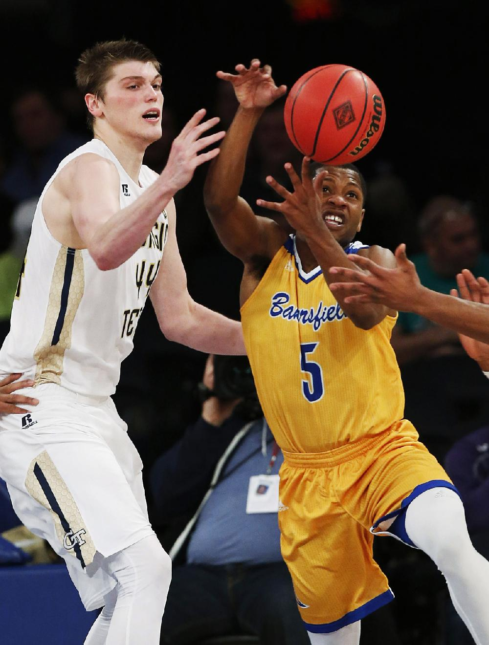 Cal State Bakersfield guard Dedrick Basile (right) and ...