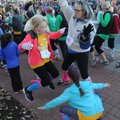 Girls dance to warm up and stretch in November before taking part in the Girls on the Run 5K run in ...