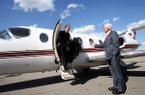 Arkansas athletics director Frank Broyles greets Dana Altman as he steps off a university plane on Tuesday, April 2, 2007, at Drake Field in Fayetteville. Altman would be introduced as the Razorbacks' head basketball coach later that day, but quit 24 hours later to return to his old job at Creighton.