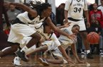 Arkansas Hawks players Ja'Mon Smith, left, and Desi Sills, center, along with Dallas Pacers' Jordan Massenburg scramble for a loose ball during the first round in the Real Deal in the Rock Tournament at P.A.R.K. Friday, March 31, 2017, in Little Rock.