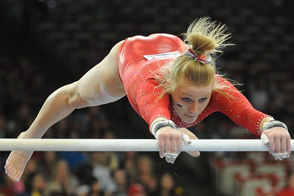 Arkansas' Makenzie Anderson competes Saturday, April 1, 2017, in the bars portion of the NCAA Gymnastics Fayetteville Regional in Barnhill Arena in Fayetteville.